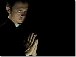 praying_priest_440